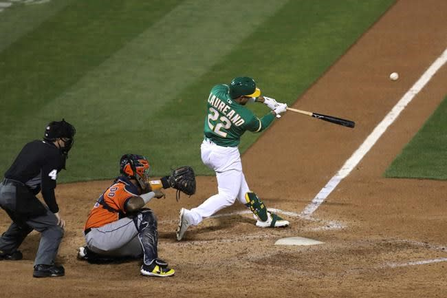 Laureano strikes back, 2-out hit in 9th puts A's past Astros