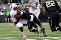 Stanford running back Barry Sanders (26) is tackled during the first quarter against Stanford in an NCAA college football game in Eugene, Ore., Saturday, Nov. 1, 2014. (AP Photo/Ryan Kang)