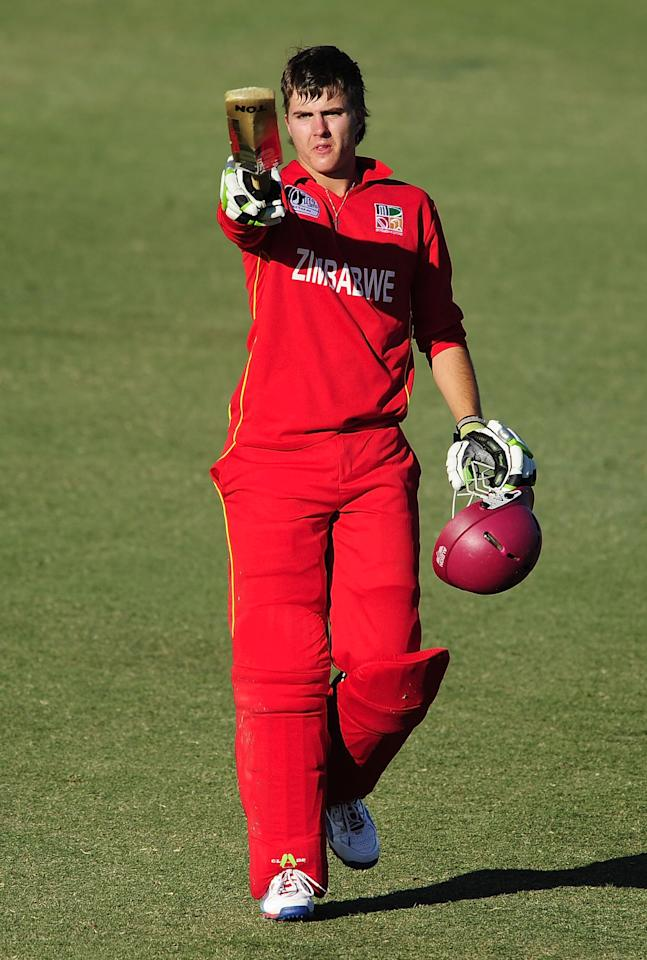 TOWNSVILLE, AUSTRALIA - AUGUST 14:  Malcolm Lake of Zimbabwe celebrates after scoring a century during the ICC U19 Cricket World Cup 2012 match between India and Zimbabwe at Tony Ireland Stadium on August 14, 2012 in Townsville, Australia.  (Photo by Ian Hitchcock-ICC/Getty Images)