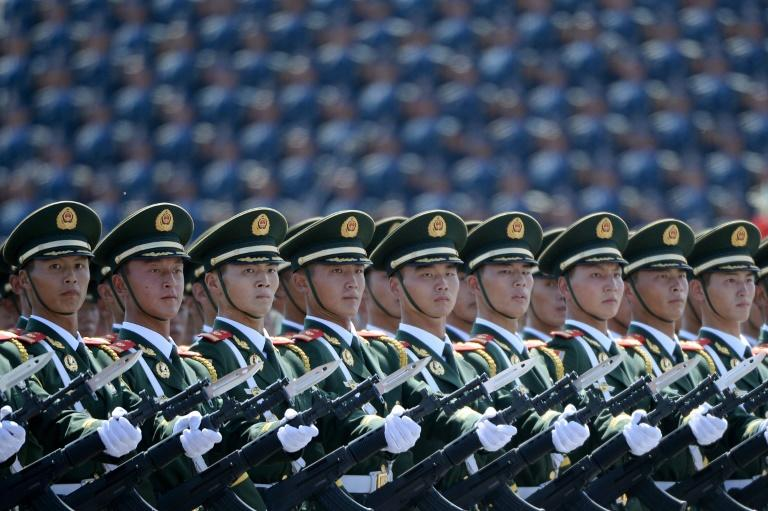 Chinese soldiers marching in formation during a 2015  parade at Tiananmen Square in Beijing