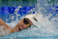 Robert Finke, of the United States, swims in a heat of the men's 800-meter freestyle at the 2020 Summer Olympics, Tuesday, July 27, 2021, in Tokyo, Japan. (AP Photo/Martin Meissner)