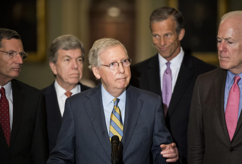 """Senate Majority Leader Mitch McConnell, center, called the latest accusation against Supreme Court nominee Brett Kavanaugh """"another orchestrated, last-minute hit on the nominee."""" (Bill Clark/CQ Roll Call via Getty Images)"""