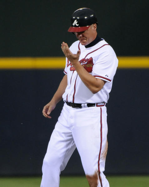 Atlanta Braves' Chipper Jones looks at his hand after stealing second base during the first inning of a baseball game against the Chicago Cubs on Tuesday, July 3, 2012, at Turner Field in Atlanta. Jones was named to the NL All-Star roster earlier Tuesday. (AP Photo/David Tulis)