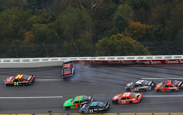 TALLADEGA, AL - OCTOBER 23: Regan Smith, driver of the #78 Furniture Row Companies Chevrolet, crashes as Mark Martin, driver of the #5 GoDaddy.com Chevrolet, and Denny Hamlin, driver of the #11 FedEx Office Toyota, make contact during the NASCAR Sprint Cup Series Good Sam Club 500 at Talladega Superspeedway on October 23, 2011 in Talladega, Alabama. (Photo by Kevin C. Cox/Getty Images for NASCAR)