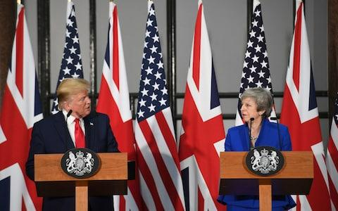 Donald Trump and Theresa May at the joint press conference - Credit: PA