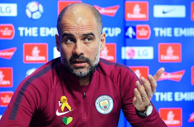 Pep Guardiola has been wearing a yellow ribbon on his shirt during press conferences and games this season. (Getty)