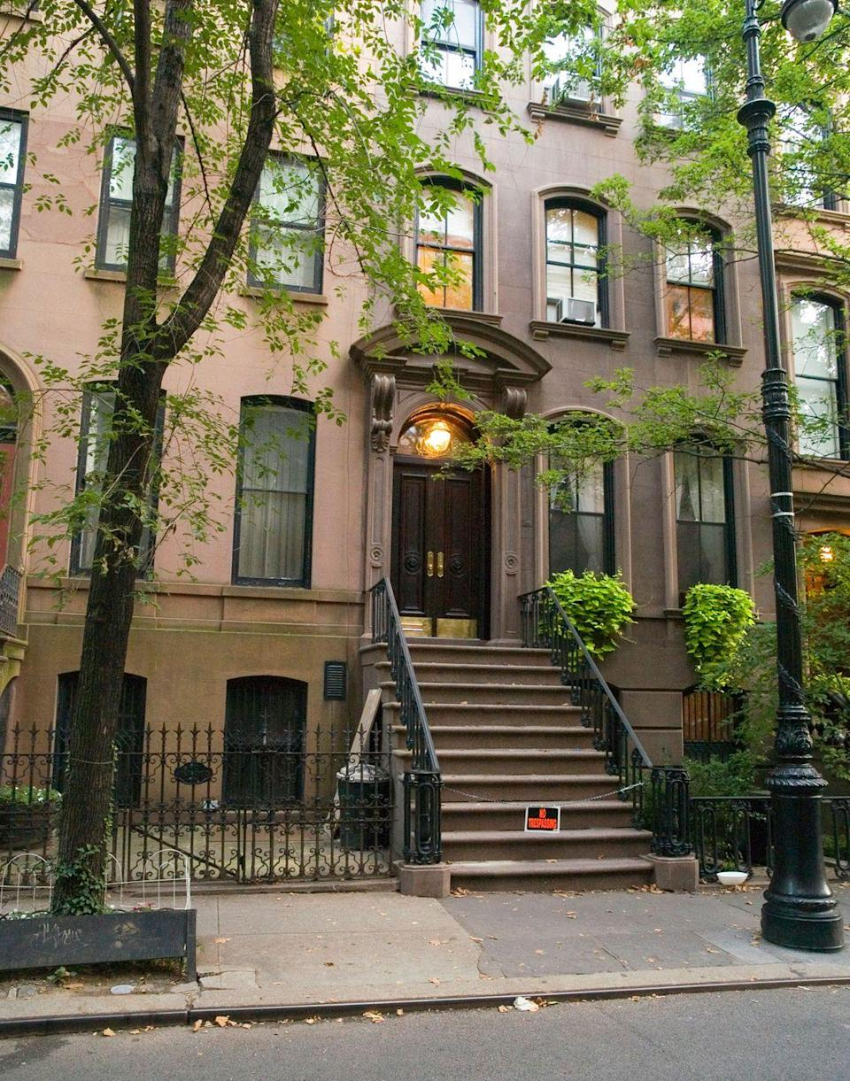 """<p>Fans know that Carrie Bradshaw's apartment was basically the fifth main character throughout the series' run and into the first movie. Fans can always be spotted outside of her small-but-lovable apartment. It's gotten so much attention that the homeowners put up a chain blocking the stairs and a """"no trespassing"""" sign, so please be respectful of their wishes, if you do walk by.</p><p>66 Perry St, New York, NY 10014</p>"""