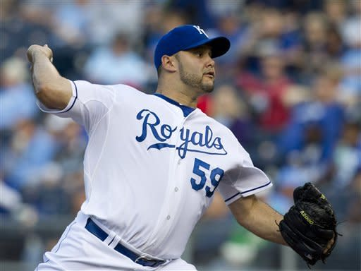 Kansas City Royals starter Felipe Paulino pitches to an Oakland Athletics batter during the first inning of a baseball game in Kansas City, Mo., Friday, June 1, 2012. (AP Photo/Orlin Wagner)