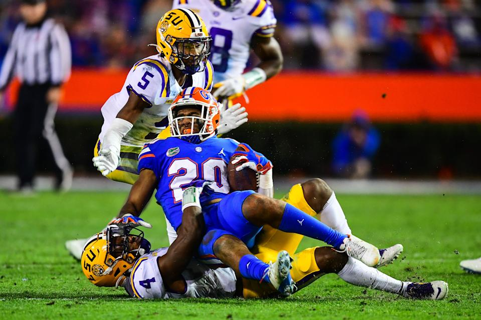 GAINESVILLE, FL - DECEMBER 12: Todd Harris Jr. #4 of the LSU Tigers makes a tackle against the Florida Gators at Ben Hill Griffin Stadium on December 12, 2020 in Gainesville, Florida. (Photo by Gus Stark/Collegiate Images/Getty Images)