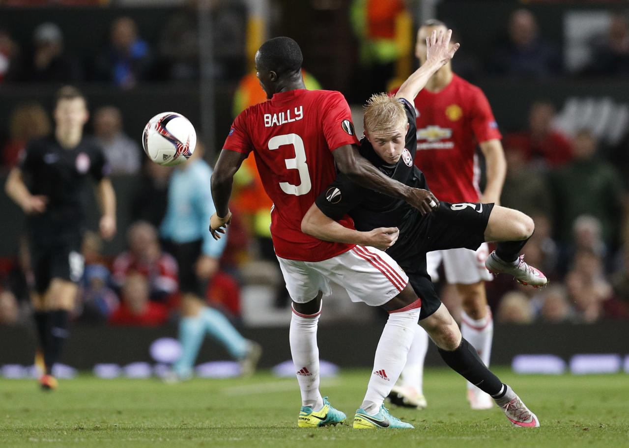 Britain Soccer Football - Manchester United v FC Zorya Luhansk - UEFA Europa League Group Stage - Group A - Old Trafford, Manchester, England - 29/9/16 Manchester United's Eric Bailly in action with FC Zorya Luhansk's Vladyslav Kulach  Reuters / Darren Staples Livepic EDITORIAL USE ONLY.