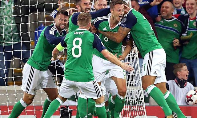 Jonny Evans, second right, is mobbed by team-mates after putting Northern Ireland ahead against the Czech Republic.