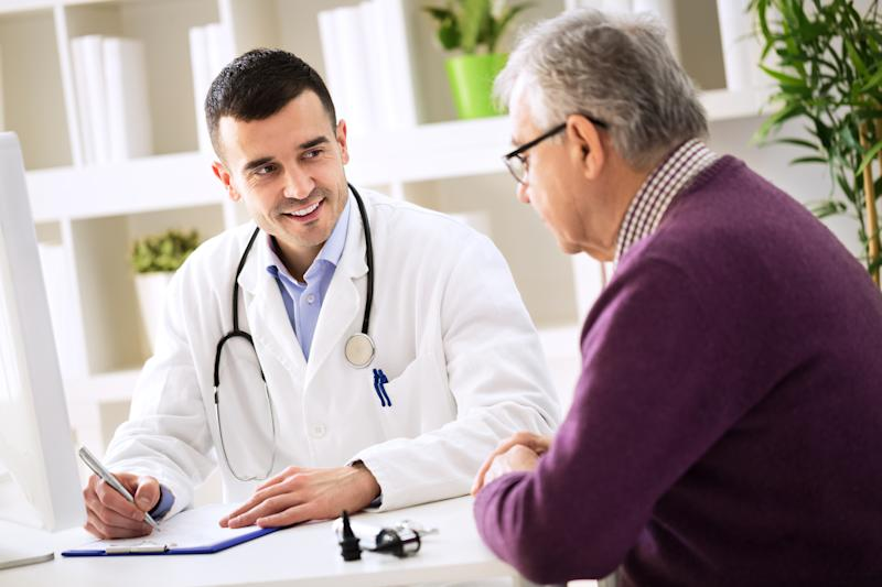 Doctor talking to patient about health insurance.
