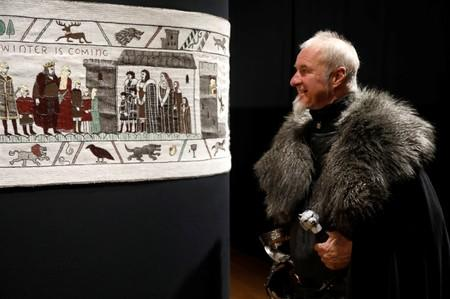 Guide William Van Der Kells of Winterfell Tours looks at the Game of Thrones Tapestry in Bayeux