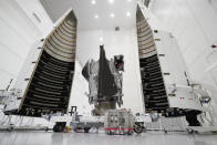 FILE - This Wednesday, Sept. 29, 2021 file photo shows NASA's Lucy spacecraft with its housing at the AstroTech facility in Titusville, Fla. It will be first space mission to explore a diverse population of small bodies known as the Jupiter Trojan asteroids. (AP Photo/John Raoux, File)