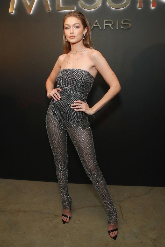 <p>On September 12, Gigi Hadid took a break from New York Fashion Week to attend the launch of Messika By Gigi Hadid collection. Thanks to her sparkly jumpsuit, we're already craving party season. <em>[Photo: Getty]</em> </p>