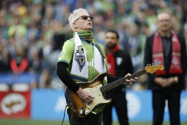 Pearl Jam guitarist Mike McCready performs the national anthem before the MLS Cup between the Seattle Sounders and the Toronto FC at CenturyLink Field. Mandatory Credit: Joe Nicholson-USA TODAY Sports