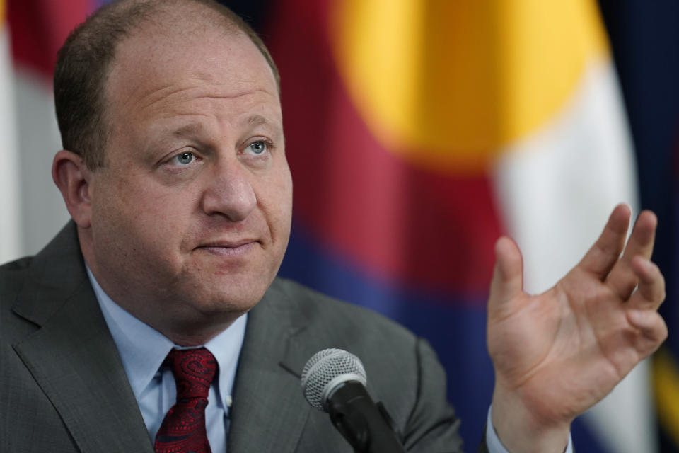 """FILE - In this March 9, 2021, file photo, Colorado Governor Jared Polis makes a point during a news conference in Denver. Gov. Polis says he will embark on a statewide tour to hear from residents and gather ideas for how to spend the state's portion of the federal $1.9 trillion American Rescue Plan. Polis and bipartisan leadership from the state legislature will go on a """"Build Back Stronger Statewide Listening Tour"""" to seven different areas of the state to hear from small businesses, local elected officials and sectors disproportionately impacted by the pandemic. (AP Photo/David Zalubowski, File)"""