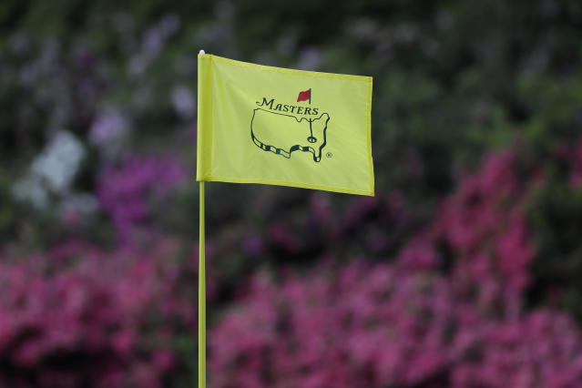 FILE - In this April 11, 2019, file photo, the flag on the 13th hole blows in the wind during the first round for the Masters golf tournament in Augusta, Ga. Augusta National decided Friday, March 13, 2020, to postpone the Masters because of the spread of the coronavirus. Club chairman Fred Ridley says he hopes postponing the event puts Augusta National in the best position to host the Masters and its other two events at some later date. Ridley did not say when it would be held.(AP Photo/David J. Phillip, Fil)