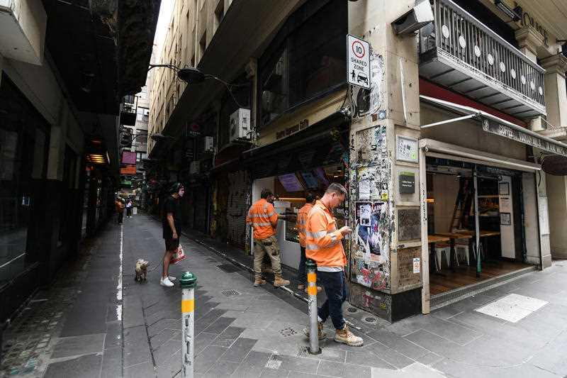 People wait for takeaway food and coffee at Centre Place in Melbourne.