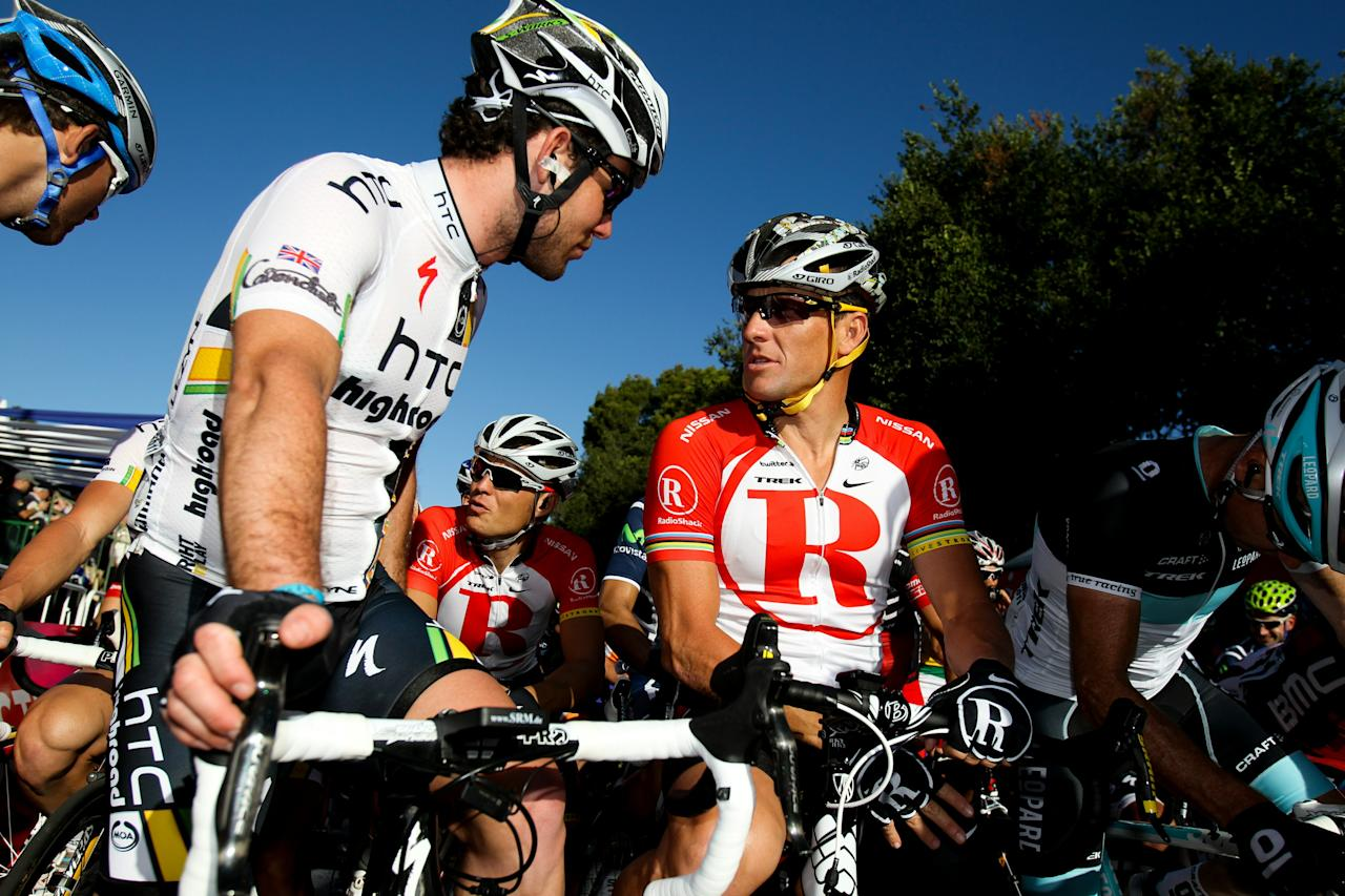 Lance Armstrong of the US (R) talks with Mark Cavendish (L) of Britain as they prepare to take part in the 51 km Cancer Council Classic cycling race, part of the 2011 Tour Down Under, in Adelaide on January 16, 2011. The Tour Down Under cycling event runs from January 16-23.  IMAGE STRICTLY RESTRICTED TO EDITORIAL USE  STRICTLY NO COMMERCIAL USE     AFP PHOTO / MARK GUNTER (Photo credit should read Mark Gunter/AFP/Getty Images)