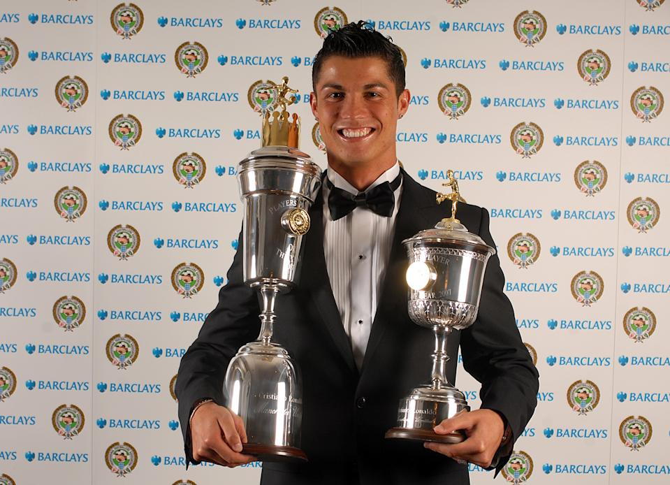 Manchester United's Cristiano Ronaldo with his PFA Young Player of the Year award and his PFA Player of the Year award at the Grosvenor House Hotel (Photo by Daniel Hambury - PA Images via Getty Images)