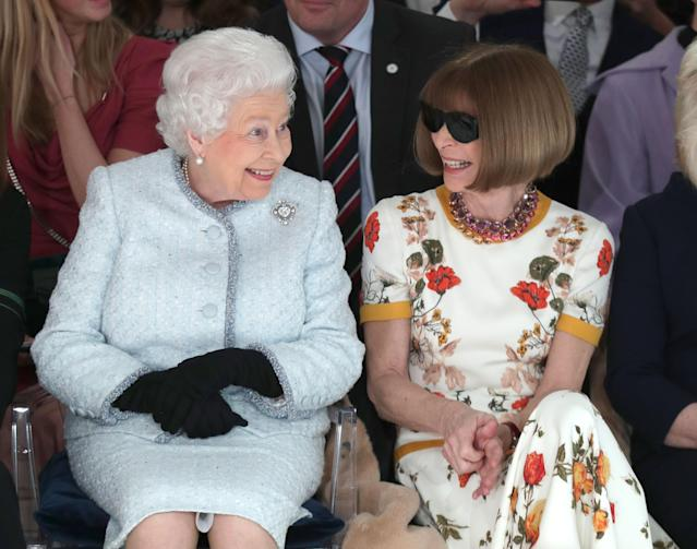 Anna Wintour and Queen Elizabeth enjoyed London Fashion Week, despite their bumpy greeting. (Photo: Getty Images)