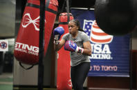 """USA Boxing team member Naomi Graham takes part in drills during a media day for the team in Colorado Springs, Colo., Monday, June 7, 2021. Although she loved the sport and knew she wanted to fight, the sight of gold medalists Nicola Adams, Katie Taylor and Claressa Shields on the medal stand at the London Olympics in 2012 filled her with even more purpose. """"I always had the dream, but before (2012), women couldn't dream of going to the Olympics,"""" Graham said.(AP Photo/David Zalubowski)"""