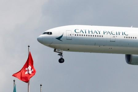 A Cathay Pacific plane lands at Hong Kong airport after it reopened following clashes between police and protesters