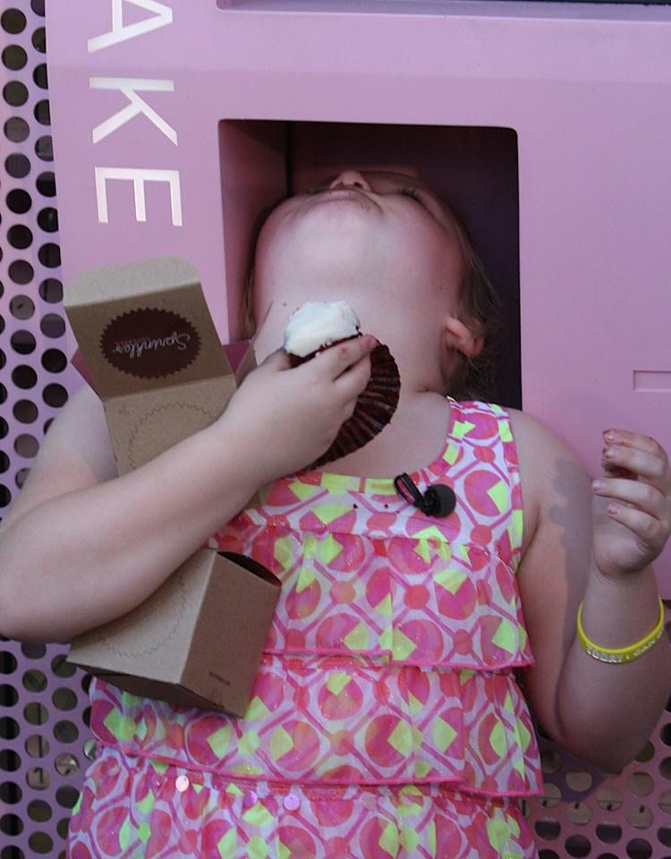 Taping for her reality show, 'Here Comes Honey Boo Boo' star Alana Thompsn is seen in Beverly Hills hitting up the famous Sprinkles cupcake ATM. Alana manages to get 2 cupcakes out and eat them both, and some is still seen on her face when she is done. She also peeks inside Sprinkles to say hello to the employees before getting back out on the street for filming.   Pictured: Alana Thompson  Ref: SPL448365  161012  Picture by: BUZZPAPS / Splash News   Splash News and Pictures Los Angeles:310-821-2666 New York:212-619-2666 London:870-934-2666 photodesk@splashnews.com