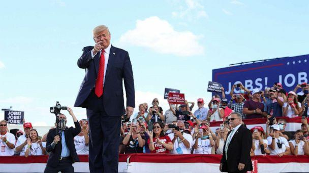 PHOTO: President Donald Trump gestures in front of supporters at Basler Flight Service in Oshkosh, Wis., Aug. 17, 2020. (Tom Brenner/Reuters)