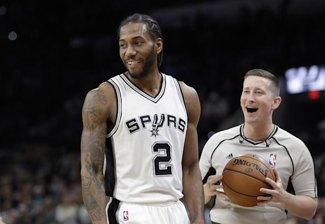 Kawhi Leonard smiles! He smiles! No, for real! (AP)