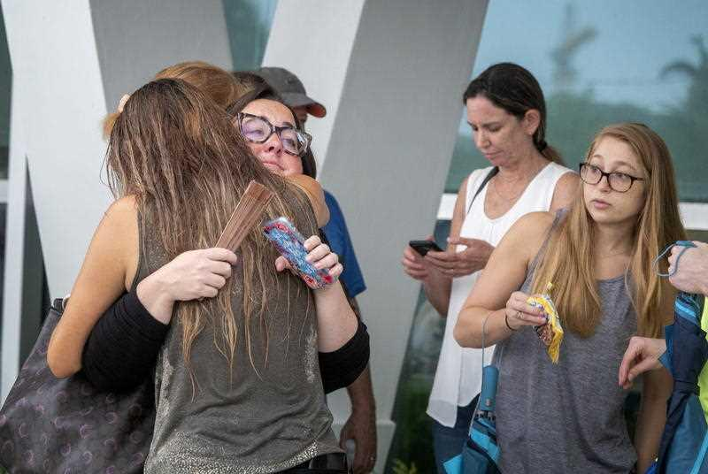 Families and friends of people that could been at the partial collapse of a 12-storey condominium building in Surfside, are waiting for information at the Town of Surfside Community Center in Surfside, Florida.