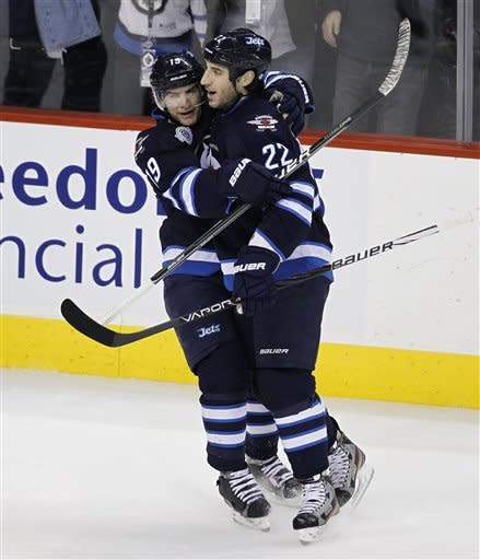 Winnipeg Jets' Jim Slater (19) and Chris Thorburn (22) celebrate after Thorburn scored to tie the game against the Toronto Maple Leafs in the first period of an NHL hockey game in Winnipeg, Manitoba, Tuesday, Feb. 7, 2012. (AP Photo/The Canadian Press, Trevor Hagan)
