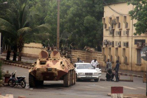 Soldiers loyal to Captain Amadou Haya Sanogo sit on an armoured vehicle at the Patrice Lumouda roundabout in Bamako last week. A month after handing power to civilians, Mali's ex-junta is resisting a return to barracks, threatening to disrupt a transition to democratic rule in Bamako while Islamists retain a firm hold on the north