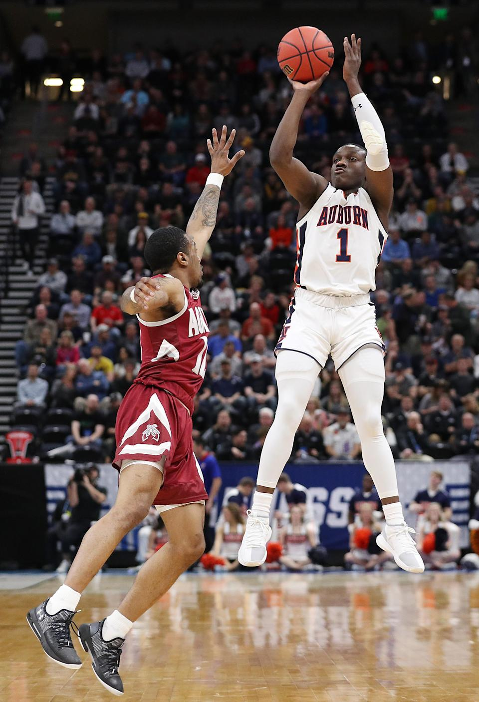 <p>Jared Harper #1 of the Auburn Tigers shoots the ball during the first half against the New Mexico State Aggies in the first round of the 2019 NCAA Men's Basketball Tournament at Vivint Smart Home Arena on March 21, 2019 in Salt Lake City, Utah. (Photo by Patrick Smith/Getty Images) </p>