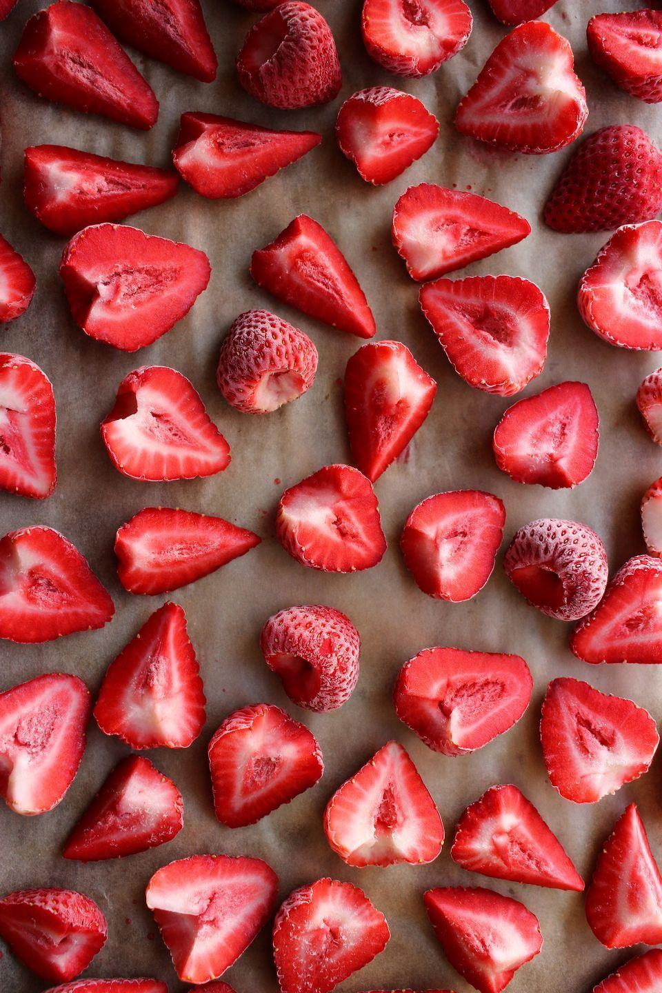 """<p>Properly frozen strawberries are an excellent start to any dessert.</p><p>Get the recipe from <a href=""""https://www.delish.com/cooking/recipe-ideas/a32435072/how-to-freeze-strawberries/"""" rel=""""nofollow noopener"""" target=""""_blank"""" data-ylk=""""slk:Delish"""" class=""""link rapid-noclick-resp"""">Delish</a>.<br></p>"""