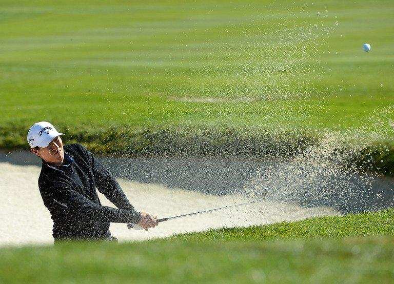 James Hahn hits out of the bunker on the first hole during the third round of the AT&T Pebble Beach National Pro-Am on February 9, 2013 in Pebble Beach, California. Hahn shares the lead at on 12-under 202 with Brandt Snedeker
