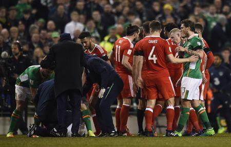 Football Soccer - Republic of Ireland v Wales - 2018 World Cup Qualifying European Zone - Group D - Aviva Stadium, Dublin, Republic of Ireland - 24/3/17 Republic of Ireland's Seamus Coleman receives medical attention Reuters / Clodagh Kilcoyne Livepic