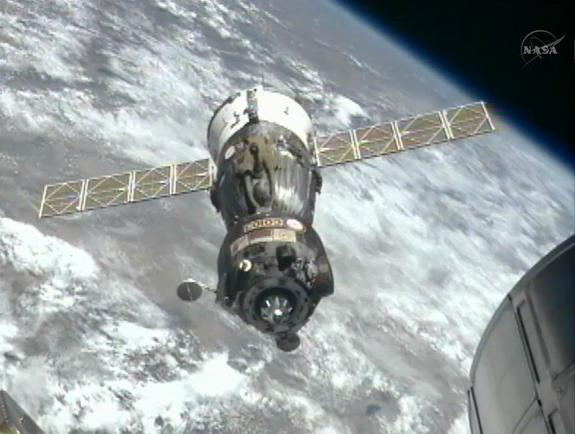 The Russian Soyuz TMA-03M backs away from the International Space Station after undocking to return three members of the Expedition 31 crew to Earth on July 1, 2012, in this still from a NASA broadcast.