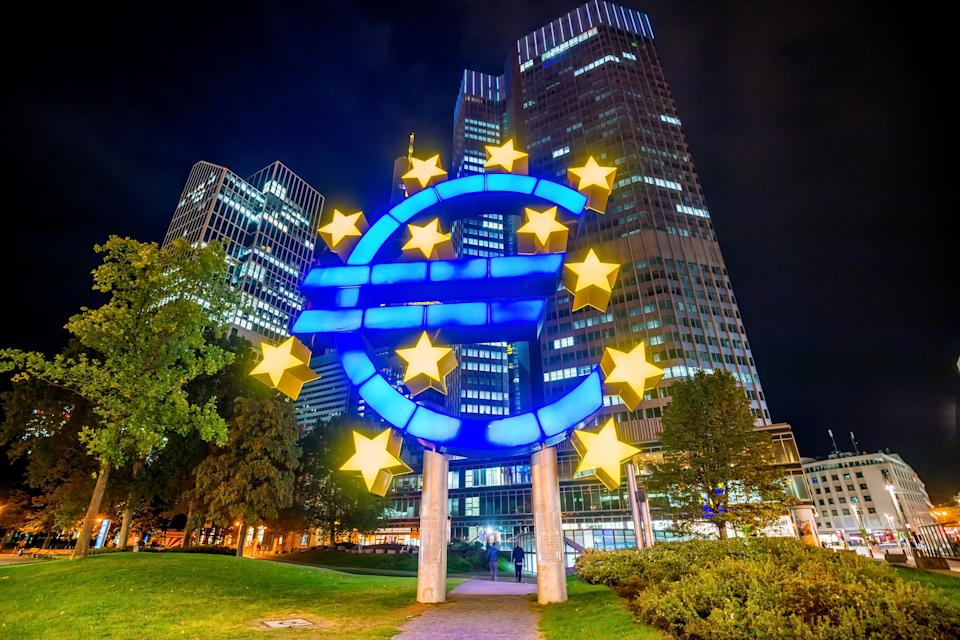 Business district in Frankfurt am Main with giant Euro sign, Germany.