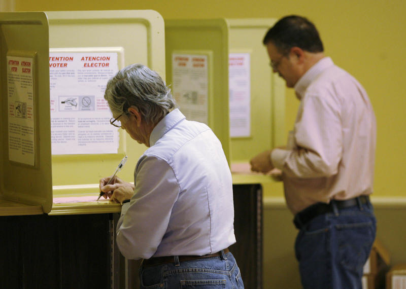Voters fill out their ballots for the Republican presidential primary at the Faith Assembly church in Tulsa, Okla. on Tuesday, March 6, 2012. (AP Photo/The World,Matt Barnard) TV OUT; TULSA OUT