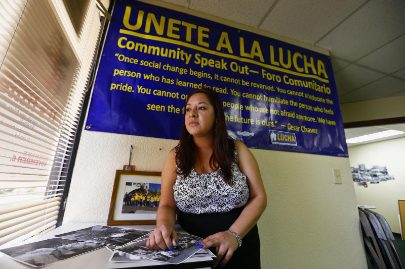 Reyna Avila, who recently received a work permit and Social Security card under new Obama administration policy for young immigrants, is shown here at her place of work Tuesday, April 2, 2013, in Phoenix. Obama's decision to allow hundreds of thousands of young illegal immigrants to stay in the country and work, marked the biggest shift in immigration policy in decades. (AP Photo/Ross D. Franklin)