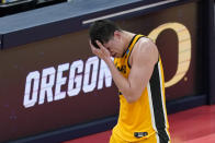Iowa's Luka Garza reacts as he taken out of the game during the second half of a second-round game against Oregon in the NCAA men's college basketball tournament at Bankers Life Fieldhouse, Monday, March 22, 2021, in Indianapolis. Oregon won 95-80. (AP Photo/Darron Cummings)
