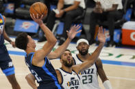 Oklahoma City Thunder center Isaiah Roby, left, shoots in front of Utah Jazz center Rudy Gobert, center, and forward Royce O'Neale (23) in the second half of an NBA basketball game Friday, May 14, 2021, in Oklahoma City. (AP Photo/Sue Ogrocki)