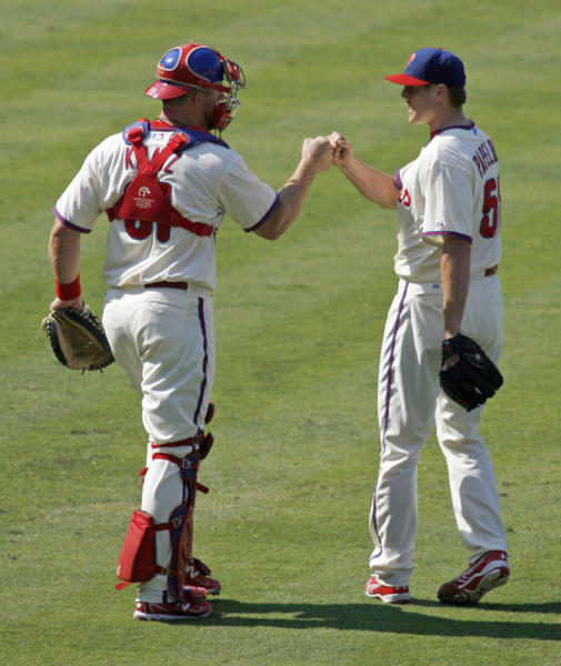 Philadelphia Phillies' Jonathan Papelbon, right celebrates with catcher Erik Kratz after defeating the New York Mets 3-2 in a baseball game Thursday, Aug. 30, 2012, in Philadelphia. (AP Photo/H. Rumph Jr)