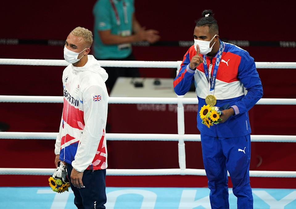 Ben Whittaker and Cuba's Arlen Lopez on the podium after the Olympic final bout (Mike Egerton/PA) (PA Wire)
