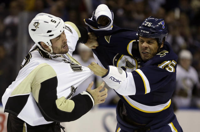 Pittsburgh Penguins' Deryk Engelland, left, and St. Louis Blues' Ryan Reaves fight during the first period of an NHL hockey game on Saturday, Nov. 9, 2013, in St. Louis. (AP Photo/Jeff Roberson)