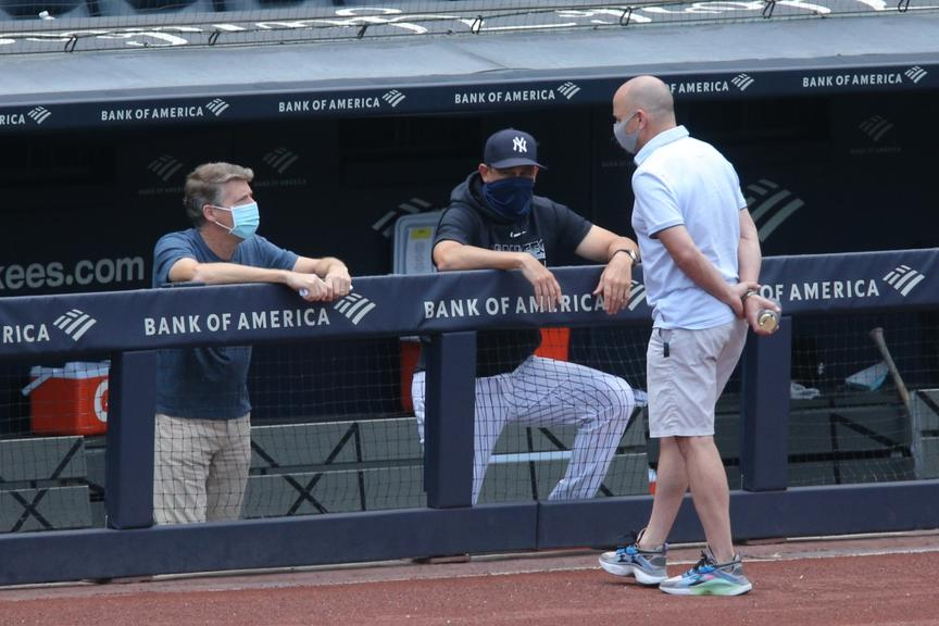 Hal Steinbrenner in the dugout with Aaron Boone, Brian Cashman