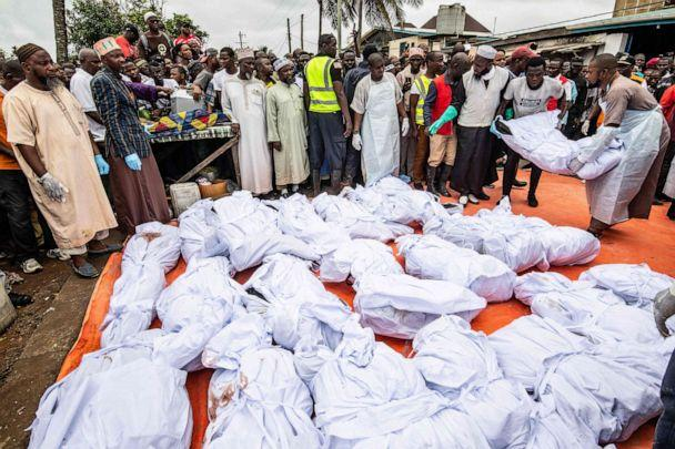 PHOTO: After being made ready for burial, men lay one of many bodies who were killed in an overnight fire at a Koranic school, on plastic sheeting as they are prepared for burial, in Monrovia, Sept. 18, 2019. (Carielle Doe/AFP/Getty Images)