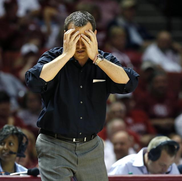 Louisville coach Jeff Walz stands on the sideline during the first half of an NCAA college basketball game in Norman, Okla., Sunday, Nov. 17, 2013. (AP Photo/Bryan Terry)